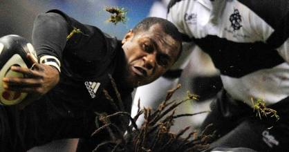Sitiveni Sivivatu attempts to make an offload during the All Blacks clash with the Barbarians in London in 2009.