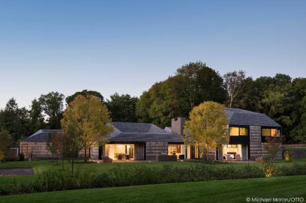 Bates Masi + Architects designed this house in Matinecock, NY. Known as Underhill, the house references the early Quaker ...