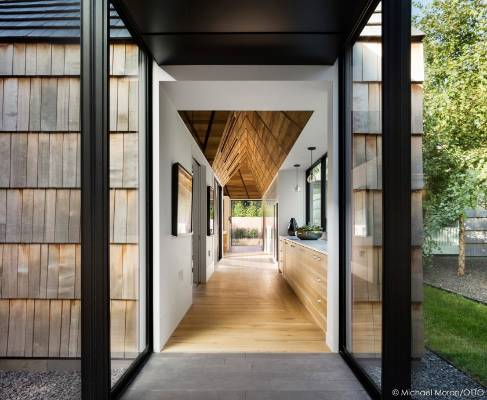 A gabled ceiling accentuates the spine of the house.
