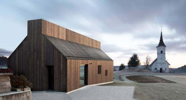 The Chimney House in Logatec, Slovenia, by Dekleva Gregoric Architects, references the region's architectural vernacular ...
