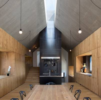 The chimney element is a strong feature of the house, both architecturally and socially. A long strip of glazing ...