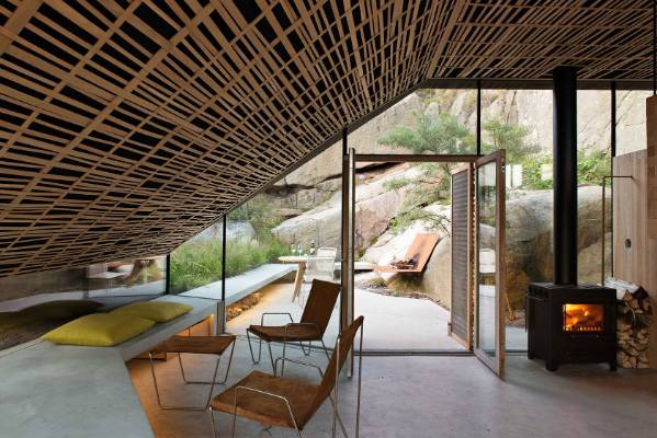 The interior walls of the Khaphullet house are solid 50/50mm oak layered with a natural sawn texture, while the acoustic ...