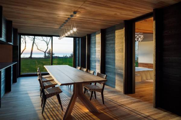 The interiors of the Lake Michigan house embody the indigenous landscape that once thrived with old growth ash.