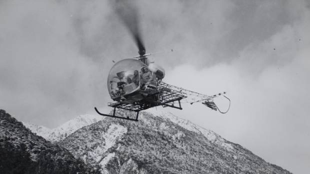 A helicopter leaves Arthur's Pass to assist in the rescue attempt. Photo published June 25, 1966.