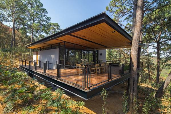 This house, in Avandaro, Valle de Bravo, Mexico, was designed by Broissin Architects to fit around the existing trees on ...