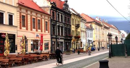 Early-morning bikers on Kosice's main street, Hlavna Ulica. The cafe terraces that line the street are bustling most ...