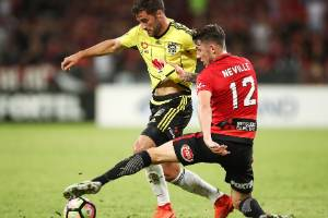 SYDNEY, AUSTRALIA - MARCH 19:  Thomas Doyle of the Phoenix competes with Scott Neville of the Wanderers during the round ...