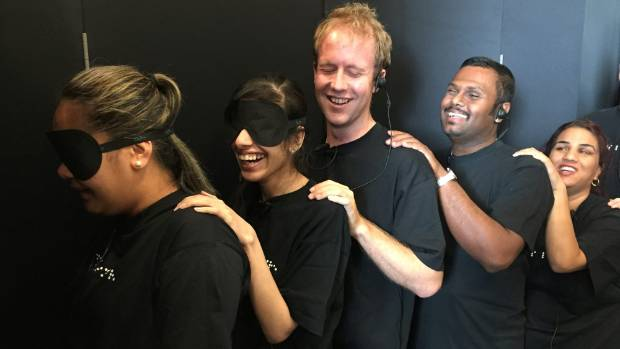 Blind waiters prepare to serve guests at the Dans Le Noir dining experience at Auckland's Rydges Hotel.