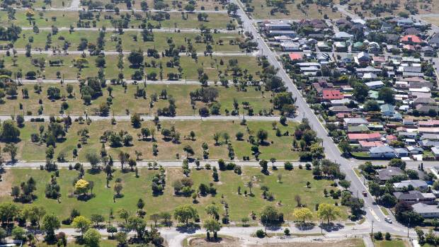 Aerial photo of houses bordering the residential red zone in Avondale.
