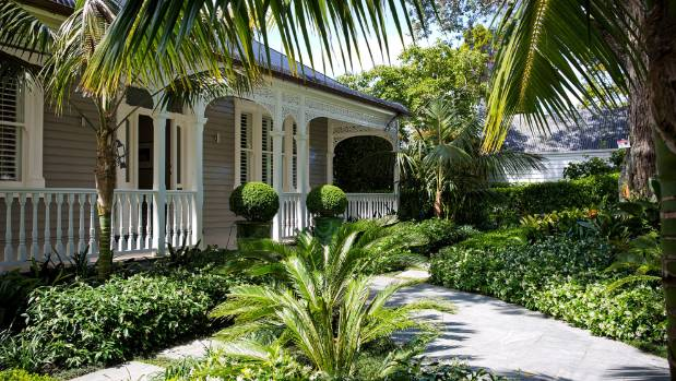 This multilayered garden in Auckland guides visitors to the front door of a gracious villa; the kentia palms and orange ...