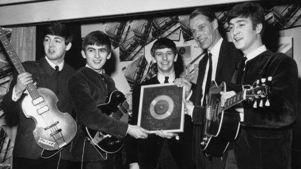 The Beatles, shown here with EMI producer George Martin in 1963, partied up large in the block.