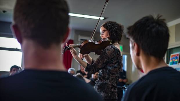 Christchurch Symphony Orchestra musician Cathy Irons shows the inmates some of what she's capable of with a violin.