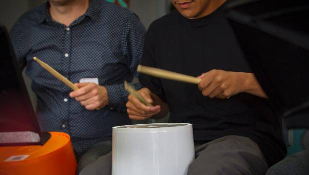 Percussionists use buckets to form the beat.