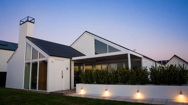 This four-bedroom home in Waitakiri is 225 square metres. including a two-car garage with laundry. The open-plan design, ...