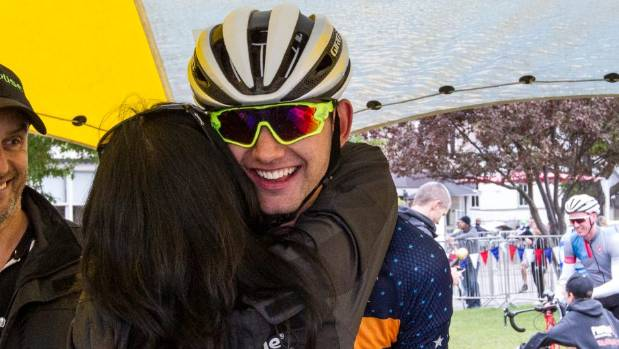 Christchurch cyclist Keagan Girdlestone gets a hug from his mum after completing Le Race last weekend.