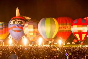 Seventeen balloons lit up for the Zuru Nightglow, choreographed to music.