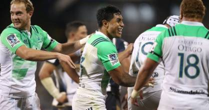 Midfielder Malakai Fekitoa (centre) celebrates the Highlanders' 18-13 win over the Brumbies in Canberra on Saturday ...