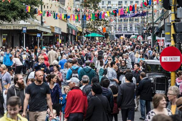 Upper Cuba St was full to the brim with festival-goers on Sunday.