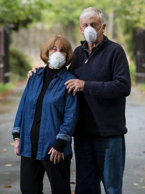 Anna and Neil Youngman wear face mask when moving around their Old West Coast Rd property.