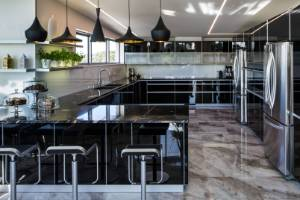 Every surface gleams in this new kitchen in a contemporary New Plymouth house at Fitzroy Beach. The cabinetry features ...