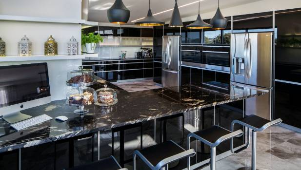 Black rules in this New Plymouth home, from the glossy kitchen to ...