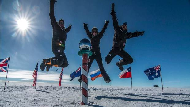 Travellers celebrate their arrival at the South Pole.