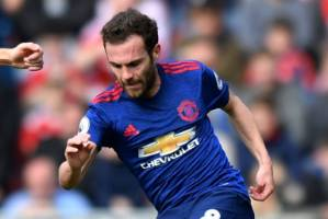 Manchester United's Juan Mata in action with Middlesbrough's Stewart Downing one of the season's latter weeks.