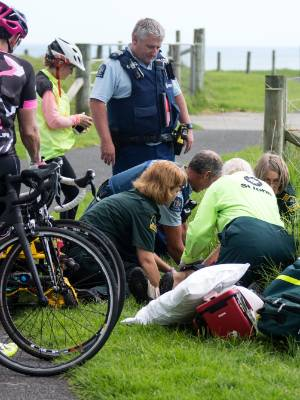Police and St John paramedics at the scene of a head on crash between two cyclists on the Coastal Walkway between Bell ...