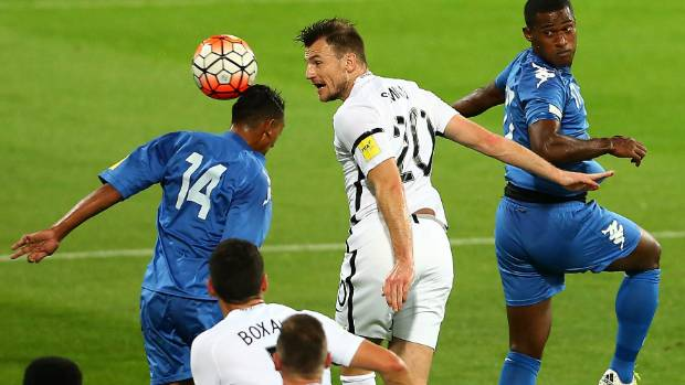 All Whites defender Tommy Smith puts in a header against Fiji on Tuesday.