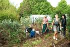 Shared gardening spaces are a great way to bring the neighbourhood together. Here, volunteers at the Ranui Community ...