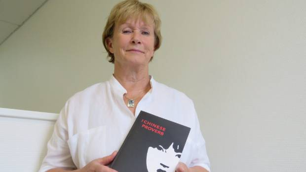 Tina Clough with her latest book, The Chinese Proverb.