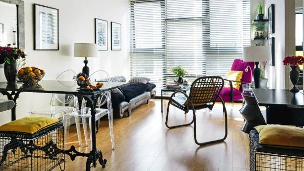 Barbara loves horizontal and vertical lines, as seen in the venetian blinds in the living area and the metal cage stools ...