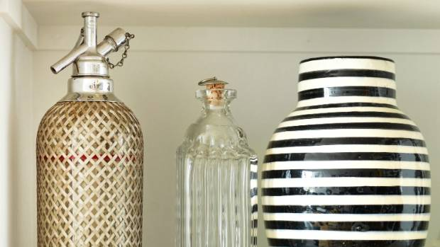 Barbara loves the lines on the vintage soda bottle, glass bottle and Moroccan black and white vase.