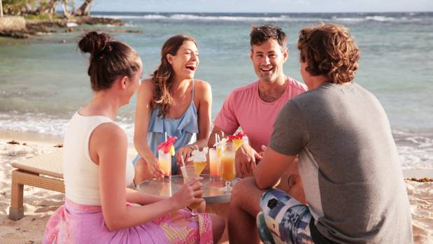 Enjoy cocktails on the beach with friends in Vanuatu.