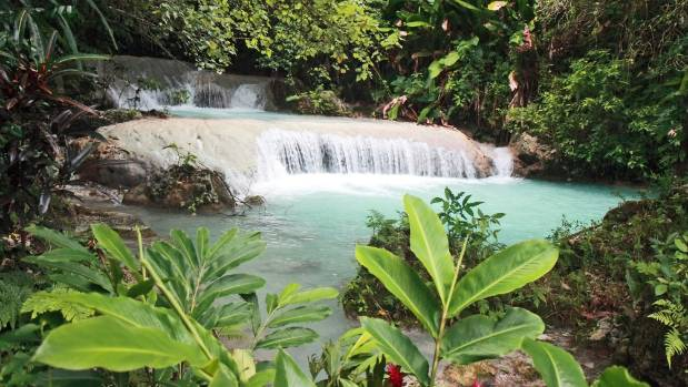 The Mele Cascades flow into a natural plunge pool.