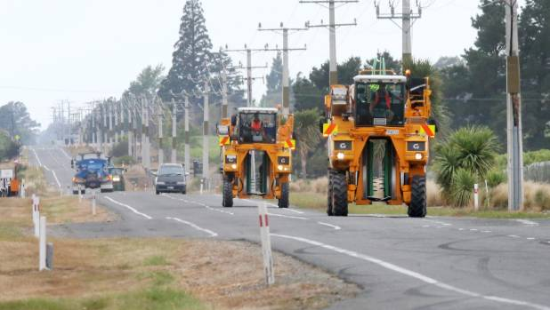 Grape harvesters make their way up the Wairau Valley during last year's harvest. (File photo)