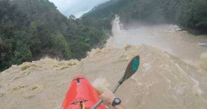 Auckland man Lawrance Simpson plunges over Hunua Falls in his kayak.