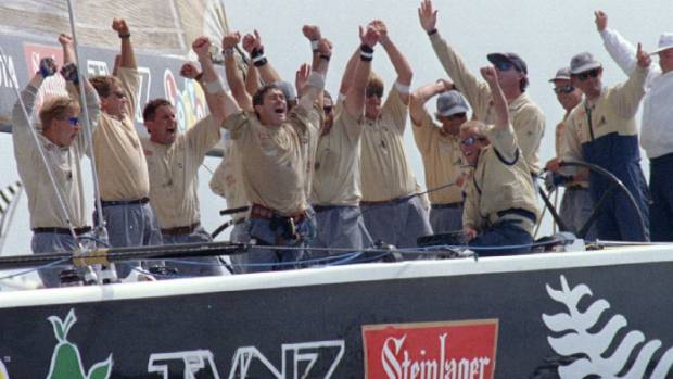 "Team New Zealand's ""Black Magic"" crew celebrate after winning the America's Cup in San Diego in 1995."