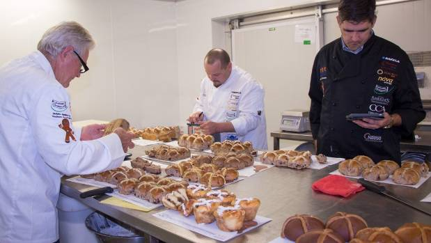 Baking Industry Association judges marking entries in the 2017 competition.
