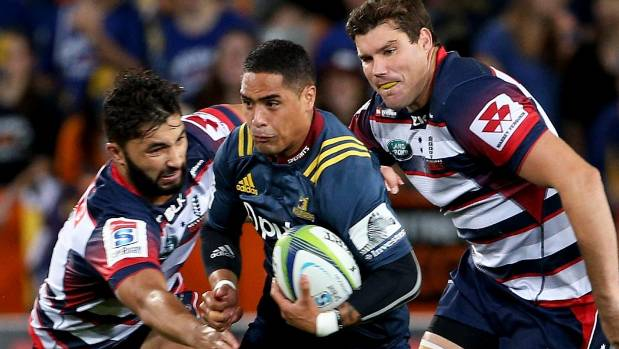 Aaron Smith of the Highlanders makes a break against the Rebels.