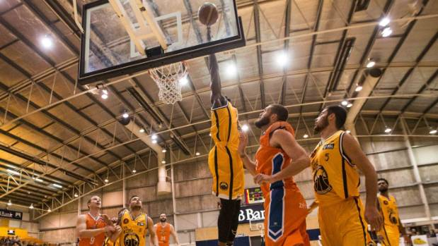 Daniel Gomis blocks a shot against the Southland Sharks.