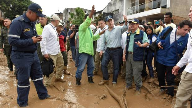 Rescuers, locals dig for Colombia flood victims, 254 die