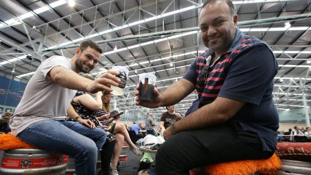 Daniel Gold and Farook Sarfraz enjoy a brew at the the inaugural Hop'n'Vine craft beer festival.