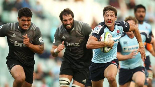 Jake Gordon of the Waratahs makes a break for the line.