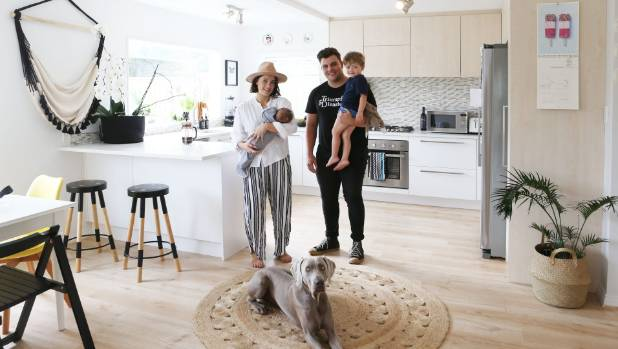 Abby and Dan Plested at home with their kids, Goldie, left, and Houston, and their dog, Sai.