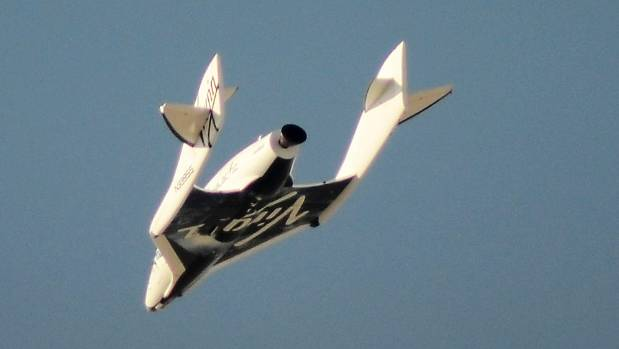 Virgin Galactic's SpaceShipTwo flies over the Mojave Desert in California April 29, 2013 shortly before successfully ...