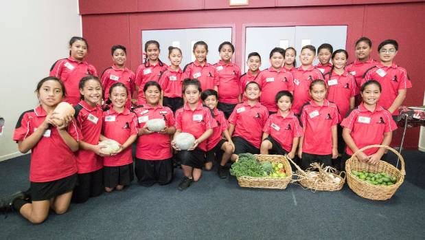 Year 5 and 6 students at East Tamaki School show off some of their recent harvest spoils.