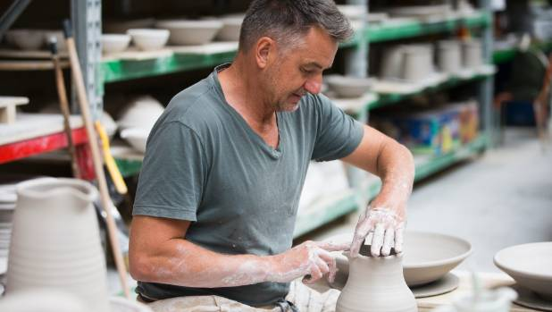 At the pottery wheel is Tony Sly's happy place.