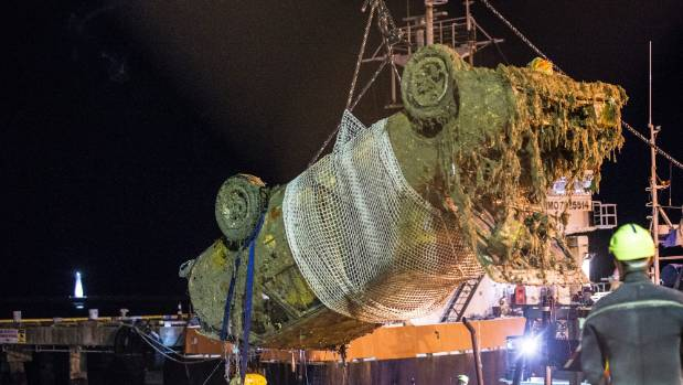 The submerged car was craned onto the wharf after an extensive salvage operation on Tuesday.