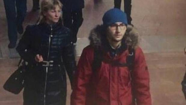 A still image of suspect Akbarzhon Jalilov (right) walking at St Petersburg's metro station shown in a police handout photo.